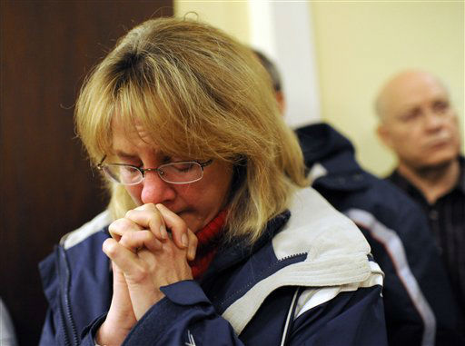 "<div class=""meta image-caption""><div class=""origin-logo origin-image ""><span></span></div><span class=""caption-text"">A mourner bows her head inside the St. Rose of Lima Roman Catholic Church at a vigil service for victims of the Sandy Hook Elementary School shooting, in Newtown, Conn. Friday, Dec. 14, 2012. (AP Photo/Andrew Gombert, Pool)</span></div>"