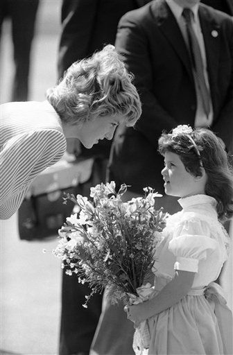 "<div class=""meta image-caption""><div class=""origin-logo origin-image ""><span></span></div><span class=""caption-text"">Princess Diana of Wales bends down to talk to seven-year-old Tara Sansbury of West Palm Beach who presented Her Royal Highness with a bouquet of flowers after the Royal couple arrived in the city for a brief one-day visit in West Palm Beach, Florida on Nov. 12, 1985. (AP Photo/Doug Jennings) (AP Photo/ Doug Jennings)</span></div>"