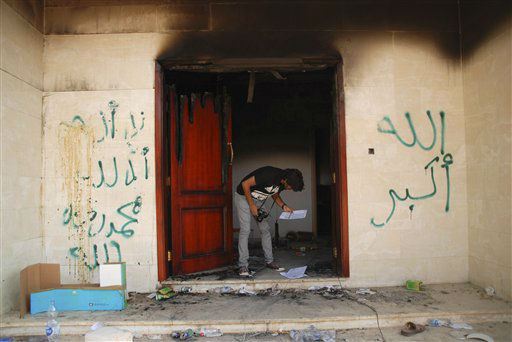 "<div class=""meta image-caption""><div class=""origin-logo origin-image ""><span></span></div><span class=""caption-text"">A man looks at documents at the U.S. consulate in Benghazi, Libya, after an attack that killed four Americans, including Ambassador Chris Stevens, Wednesday, Sept. 12, 2012. The graffiti reads, ""no God but God,""  "" God is great,"" and ""Muhammad is the Prophet."" The American ambassador to Libya and three other Americans were killed when a mob of protesters and gunmen overwhelmed the U.S. Consulate in Benghazi, setting fire to it in outrage over a film that ridicules Islam's Prophet Muhammad. Ambassador Chris Stevens, 52, died as he and a group of embassy employees went to the consulate to try to evacuate staff as a crowd of hundreds attacked the consulate Tuesday evening, many of them firing machine-guns and rocket-propelled grenades.(AP Photo/Ibrahim Alaguri) (AP Photo/ Ibrahim Alaguri)</span></div>"
