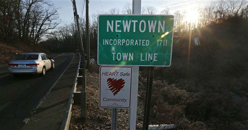"<div class=""meta ""><span class=""caption-text "">A car drives past the town line as the sun breaks the horizon, a day after a school shooting tragedy, in Newtown, Conn., Saturday, Dec. 15, 2012.  The massacre of 26 children and adults at Sandy Hook Elementary school elicited horror and soul-searching around the world even as it raised more basic questions about why the gunman, 20-year-old Adam Lanza, would have been driven to such a crime and how he chose his victims. (AP Photo/ Charles Krupa)</span></div>"