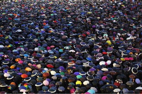 Visitors cover St. Peter&#39;s Square with their umbrellas as they wait for the election of a new pope by the cardinals in conclave in the Sistine Chapel at the Vatican, Wednesday, March 13, 2013.  <span class=meta>(AP Photo&#47; Andrew Medichini)</span>