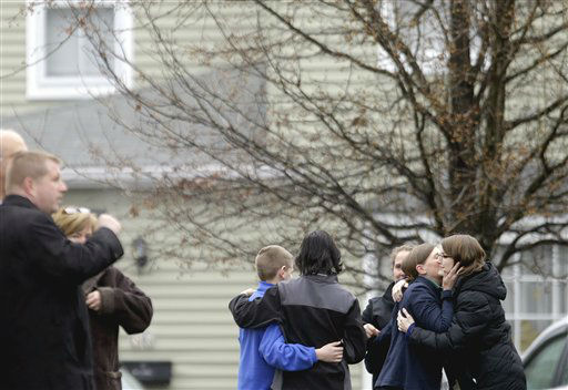 Mourners leave a funeral service for Sandy Hook Elementary School shooting victim, six-year-old Jack Pinto, Monday, Dec. 17, 2012, in Newtown, Conn. &#40;AP Photo&#47;David Goldman&#41; <span class=meta>(AP Photo&#47; David Goldman)</span>