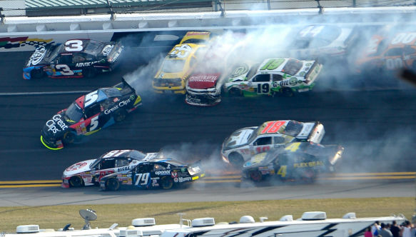 Michael Annett &#40;43&#41;, Johanna Long &#40;70&#41;, Hal Martin &#40;44&#41;, Mike Bliss &#40;19&#41;, Jason White &#40;00&#41;, Joe Nemechek &#40;87&#41;, Jeffrey Earnhardt &#40;79&#41;, Matt Kenseth &#40;18&#41;, Danny Efland &#40;4&#41; and Kasey Kahne &#40;5&#41; collide and slide as Austin Dillon &#40;3&#41; escapes between Turns 1 and 2 during the NASCAR Nationwide Series auto race at Daytona International Speedway in Daytona Beach, Fla., Saturday, Feb. 23, 2013. &#40;AP Photo&#47;Phelan M. Ebenhack&#41; <span class=meta>(AP Photo&#47; Phelan M. Ebenhack)</span>