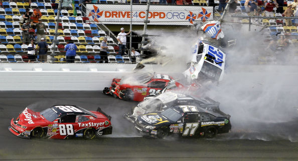 Kyle Larson &#40;32&#41; goes airborne into the catch fence in a multi-car crash involving Dale Earnhardt Jr. &#40;88&#41;, Parker Kilgerman &#40;77&#41;, Jeffery Earnhardt &#40;31&#41; and Brian Scott &#40;2&#41; during the final lap of the NASCAR Nationwide Series auto race at Daytona International Speedway, Saturday, Feb. 23, 2013, in Daytona Beach, Fla. &#40;AP Photo&#47;John Raoux&#41; <span class=meta>(AP Photo&#47; John Raoux)</span>