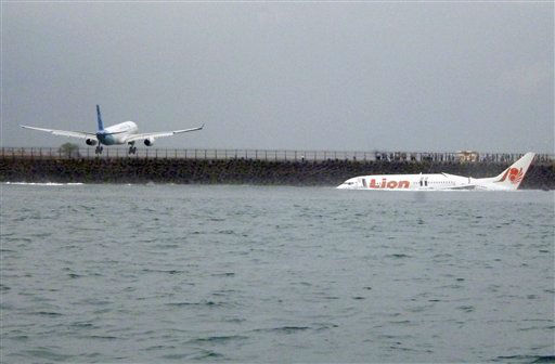 "<div class=""meta ""><span class=""caption-text "">The wreckage a crashed Lion Air plane sits on the water near the airport in Bali, Indonesia on Saturday, April 13, 2013. The plane carrying more than 100 passengers and crew overshot a runway on the Indonesian resort island of Bali on Saturday and crashed into the sea, injuring nearly two dozen people, officials said.  (AP Photo/ Uncredited)</span></div>"