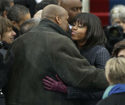First lady Michelle Obama  is greeted by her brother Craig Robinson at the ceremonial swearing-in for President Barack Obama at the U.S. Capitol during the 57th Presidential Inauguration in Washington, Monday, Jan. 21, 2013. &#40;AP Photo&#47;Pablo Martinez Monsivais&#41; <span class=meta>(AP Photo&#47; Pablo Martinez Monsivais)</span>