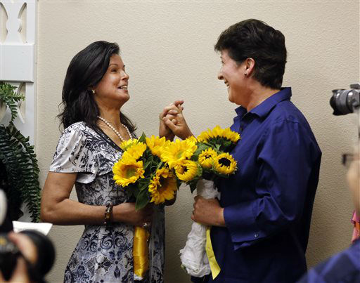 Diana Luiz, left, and Nicola Simmersbach, take their marriage vows at the Sacramento County Recorder&#39;s office Friday, June 28, 2013 in Sacramento, Calif.  A three-judge panel of the 9th U.S. Circuit Court of Appeals issued a brief order Friday afternoon dissolving, &#34;effective immediately,&#34; a stay it imposed on gay marriages while the lawsuit challenging the ban advanced through the court.  The couple had been engaged for five years and rushed to the recorders office where they became the first same-sex couple to get be married in Sacramento County after the ruling.   <span class=meta>(AP Photo&#47; Rich Pedroncelli)</span>