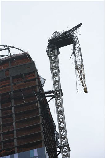 A construction crane atop a luxury high-rise dangles precariously over the streets after collapsing in high winds from Hurricane Sandy, Monday, Oct. 29, 2012, in New York. Hurricane Sandy continued on its path Monday, as the storm forced the shutdown of mass transit, schools and financial markets, sending coastal residents fleeing, and threatening a dangerous mix of high winds and soaking rain.   <span class=meta>(AP Photo&#47; John Minchillo)</span>