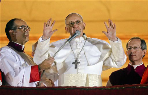 Pope Francis waves to the crowd from the central balcony of St. Peter&#39;s Basilica at the Vatican, Wednesday, March 13, 2013. Cardinal Jorge Bergoglio who chose the name of  Francis, is the 266th pontiff of the Roman Catholic Church.   <span class=meta>(AP Photo&#47; Gregorio Borgia)</span>
