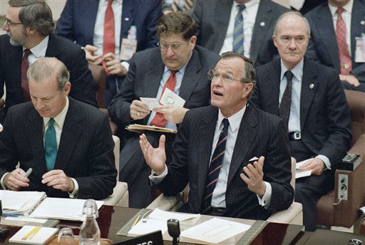 U.S. President George H. Bush talks during the special meeting of the North Atlantic Council, Monday, May 29, 1989 in Brussels. Behind Bush are White House Chief of Staff John Sununu, left, and National Security Advisor Brant Scrowcroft. Mills&#41; <span class=meta>(AP Photo&#47; Doug Mills)</span>