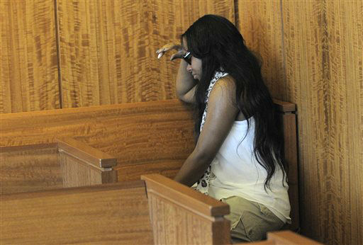 Shayanna Jenkins, fiancee of former New England Patriots football player Aaron Hernandez, weeps in the courtroom after a bail hearing for Hernandez in Fall River Superior Court Thursday, June 27, 2013, in Fall River, Mass. Hernandez, charged with murdering Odin Lloyd, a 27-year-old semi-pro football player, was denied bail.   <span class=meta>(AP Photo&#47; Ted Fitzgerald)</span>
