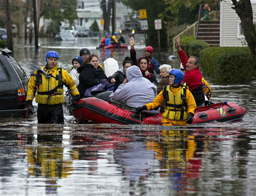 People, some waving to those on dry ground, are rescued by boat in Little Ferry, N.J. Tuesday, Oct. 30, 2012 in the wake of superstorm Sandy. Sandy, the storm that made landfall Monday, caused multiple fatalities, halted mass transit and cut power to more than 6 million homes and businesses.   <span class=meta>(AP Photo&#47; Craig Ruttle)</span>