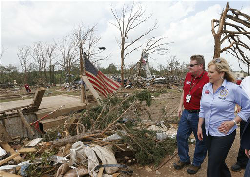 "<div class=""meta ""><span class=""caption-text "">Oklahoma Gov. Mary Fallin, right, walks through the Steelman Estates Mobile Home Park, which was hard hit in Sunday's tornado, with Albert Ashwood, left, Director of the Oklahoma Department of Emergency Management, near Shawnee, Okla., Monday, May 20, 2013. (AP Photo Sue Ogrocki) (AP Photo/ Sue Ogrocki)</span></div>"