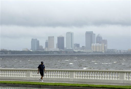 A resident walks along Bayshore Boulevanrd in between squalls blowing across the bay in Tampa, Fla., Monday, Aug. 27, 2012. The Republican National Convention has delayed it&#39;s start because of the approaching tropical storm Isaac which is churning it&#39;s way across the Gulf of Mexico.   <span class=meta>(AP Photo&#47; Chris O&#39;Meara)</span>
