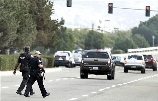 San Diego police officers carrying assault weapons cross over Harbor Drive in San Diego during a manhunt for former Los Angeles officer Christopher Dorner who police believe is responsible for three murders on Thursday, Feb. 7, 2013.  Dorner is suspected of shooting two LAPD officers who were sent to Corona to protect someone Dorner threatened in a rambling online manifesto. Thousands of police officers throughout Southern California and Nevada searched for Dorner, a former Los Angeles officer who was angry over his firing and began a deadly shooting rampage that he warned in an online posting would target those on the force who wronged him.   <span class=meta>(AP Photo&#47; Lenny Ignelzi)</span>
