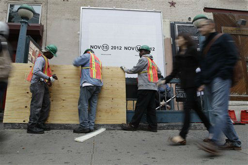 Metropolitan Transportation Authority workers cover an entrance to the Canal St. A, C, and E station with plywood to help prevent flooding, Saturday, Oct. 27, 2012 in New York. As Hurricane Sandy approaches the New York region, residents of some flood-prone areas have been told to evacuate and officials are preparing for a possible transit system shutdown. &#40;AP Photo&#47;Mary Altaffer&#41; <span class=meta>(AP Photo&#47; Mary Altaffer)</span>