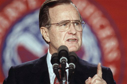 U.S. President George H. Bush gestures during a speech to the Reserve Officers Association in Washington, Wednesday evening, Jan. 23, 1991. Bush said the war against Saddam Hussein was right on schedule. The President received the Minuteman Award from the group prior to the speech.  <span class=meta>(AP Photo&#47; Ron Edmonds)</span>