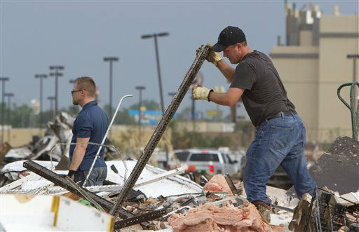 "<div class=""meta ""><span class=""caption-text "">A man searches debris near Telephone Road and SW 4th after a tornado moves through Moore, Okla. on Monday, May 20, 2013. (AP Photo/Alonzo Adams) (AP Photo/ Alonzo Adams)</span></div>"