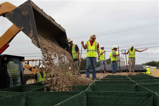 "<div class=""meta image-caption""><div class=""origin-logo origin-image ""><span></span></div><span class=""caption-text"">Workers fill Hesco baskets at a flood wall at Route 23, in advance of Tropical Storm Isaac in Plaquemines Parish, La.,  Tuesday, Aug. 28, 2012. Forecasters at the National Hurricane Center warned that Isaac, especially if it strikes at high tide, could cause storm surges of up to 12 feet (3.6 meters) along the coasts of southeast Louisiana and Mississippi and up to 6 feet (1.8 meters) as far away as the Florida Panhandle.  (AP Photo/ Gerald Herbert)</span></div>"