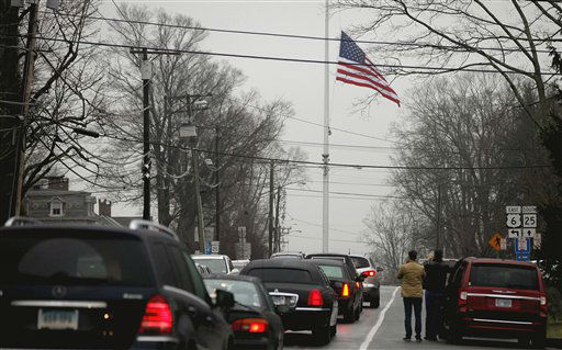 A funeral procession follows the hearse carrying the casket of Sandy Hook Elementary School shooting victim, Jack Pinto, 6, Monday, Dec. 17, 2012, in Newtown, Conn. Pinto was killed when a gunman walked into Sandy Hook Elementary School in Newtown Friday and opened fire, killing 26 people, including 20 children.&#40;AP Photo&#47;David Goldman&#41; <span class=meta>(AP Photo&#47; David Goldman)</span>