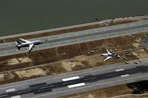 This aerial photo shows the crash site of Asiana Flight 214 at the San Francisco International Airport in San Francisco, Saturday,  July 6, 2013.   <span class=meta>(AP Photo&#47; Marcio Jose Sanchez)</span>