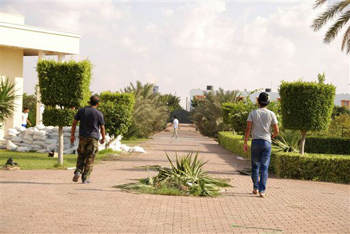 "<div class=""meta image-caption""><div class=""origin-logo origin-image ""><span></span></div><span class=""caption-text"">Libyans walk on the grounds of the U.S. consulate in Benghazi, Libya, after an attack that killed four Americans, including Ambassador Chris Stevens, Wednesday, Sept. 12, 2012. The American ambassador to Libya and three other Americans were killed when a mob of protesters and gunmen overwhelmed the U.S. Consulate in Benghazi, setting fire to it in outrage over a film that ridicules Islam's Prophet Muhammad. Ambassador Chris Stevens, 52, died as he and a group of embassy employees went to the consulate to try to evacuate staff as a crowd of hundreds attacked the consulate Tuesday evening, many of them firing machine-guns and rocket-propelled grenades.(AP Photo/Ibrahim Alaguri) (AP Photo/ Ibrahim Alaguri)</span></div>"