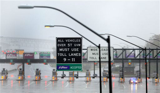 "<div class=""meta image-caption""><div class=""origin-logo origin-image ""><span></span></div><span class=""caption-text"">Toll lanes are closed at Maryland's Chesapeake Bay Bridge, which is closed because of winds from Hurricane Sandy, Monday, Oct. 29, 2012. Hurricane Sandy continued on its path Monday, as the storm forced the shutdown of mass transit, schools and financial markets, sending coastal residents fleeing, and threatening a dangerous mix of high winds and soaking rain. (AP Photo/Steve Ruark) (AP Photo/ Steve Ruark)</span></div>"