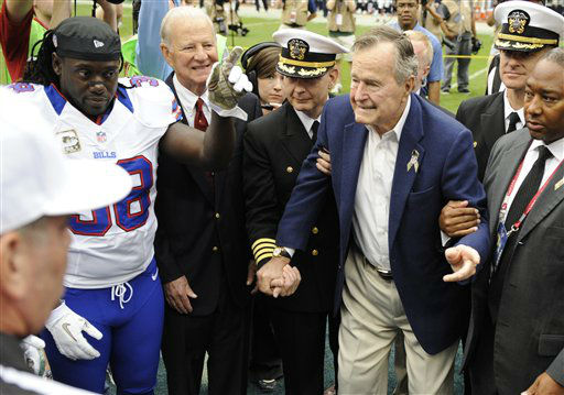 "<div class=""meta image-caption""><div class=""origin-logo origin-image ""><span></span></div><span class=""caption-text"">Former President George H.W. Bush is helped to the field for the coin toss as Buffalo Bills' Corey McIntyre (38) and former Secretary of State James Baker, left rear, look on before an NFL football game against the Houston Texans Sunday, Nov. 4, 2012, in Houston.   (AP Photo/ Dave Einsel)</span></div>"