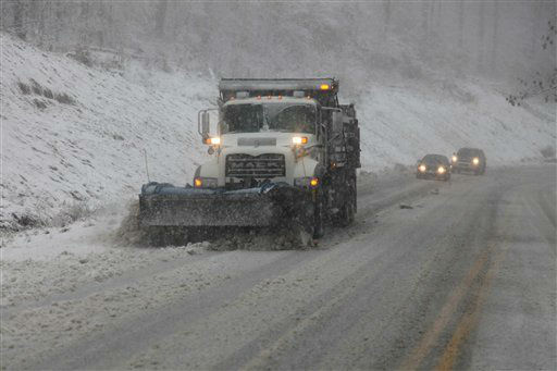 Snow plows thunder through the mountains of West Virginia as the superstorm begins it&#39;s raking of the region, Monday evening, Oct. 29, 2012. In the higher elevations of the mountains there could be from 2-3 feet of snow and blizzard conditions thru Tuesday. &#40;AP Photo&#47;Robert Ray&#41; <span class=meta>(AP Photo&#47; Robert Ray)</span>