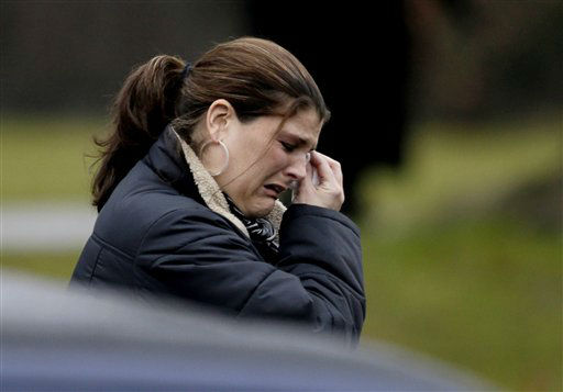 A mourner leaves the funeral service of Sandy Hook Elementary School shooting victim, Jack Pinto, 6, Monday, Dec. 17, 2012, in Newtown, Conn. Pinto was killed when a gunman walked into Sandy Hook Elementary School in Newtown Friday and opened fire, killing 26 people, including 20 children.&#40;AP Photo&#47;David Goldman&#41; <span class=meta>(AP Photo&#47; David Goldman)</span>