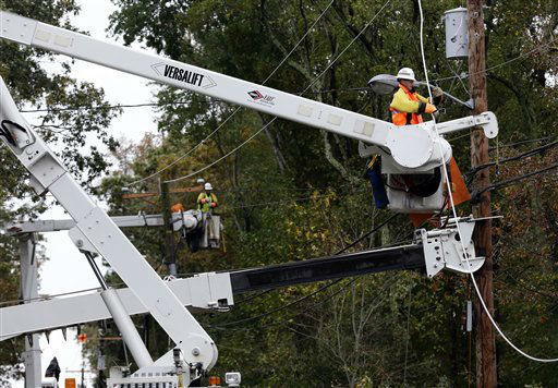Utility crews work on damaged power lines in the aftermath of superstorm Sandy in Berlin, Md. on Tuesday, Oct. 30, 2012. &#40;AP Photo&#47;Alex Brandon&#41; <span class=meta>(AP Photo&#47; Alex Brandon)</span>