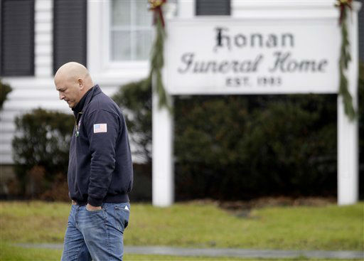 A mourner leaves a funeral service for Sandy Hook Elementary School shooting victim, Jack Pinto, 6, Monday, Dec. 17, 2012, in Newtown, Conn. Pinto as killed when a gunman walked into Sandy Hook Elementary School in Newtown Friday and opened fire, killing 26 people, including 20 children.&#40;AP Photo&#47;David Goldman&#41; <span class=meta>(AP Photo&#47; David Goldman)</span>