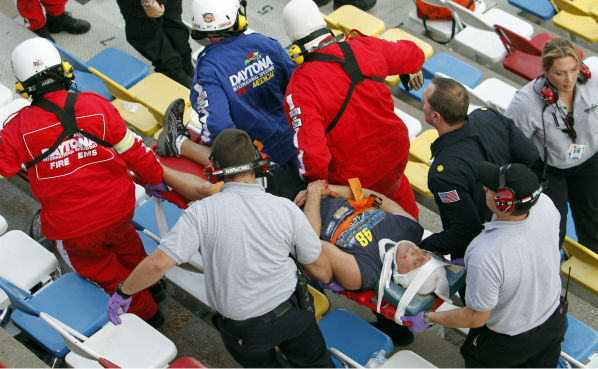 An injured spectators are treated after a crash at the conclusion of the NASCAR Nationwide Series auto race Saturday, Feb. 23, 2013, at Daytona International Speedway in Daytona Beach, Fla. Driver Kyle Larson&#39;s car hit the safety fence sending car parts and other debris flying into the stands. &#40;AP Photo&#47;David Graham&#41; <span class=meta>(AP Photo&#47; David Graham)</span>