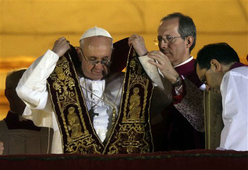 "<div class=""meta ""><span class=""caption-text "">Pope Francis puts on his sash from the central balcony of St. Peter's Basilica at the Vatican, Wednesday, March 13, 2013. Cardinal Jorge Bergoglio who chose the name of  Francis, is the 266th pontiff of the Roman Catholic Church.  (AP Photo/ Gregorio Borgia)</span></div>"