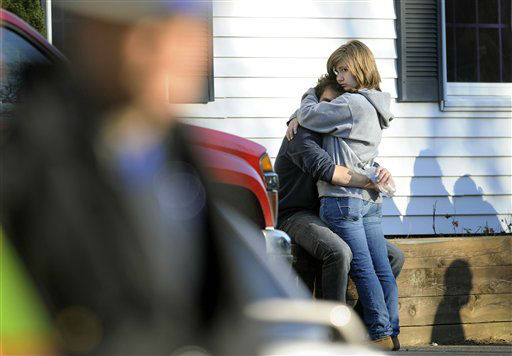 "<div class=""meta image-caption""><div class=""origin-logo origin-image ""><span></span></div><span class=""caption-text"">People embrace at a firehouse staging area for family around near the scene of a shooting at the Sandy Hook Elementary School in Newtown, Conn. where authorities say a gunman opened fire, leaving 27 people dead, including 20 children, Friday, Dec. 14, 2012.  (AP Photo/ Jessica Hill)</span></div>"