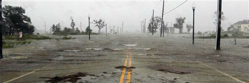 "<div class=""meta ""><span class=""caption-text "">Isaac's winds and storm surge flood parts of Waveland, Miss., Wednesday, Aug. 29, 2012, the seventh  anniversary of Hurricane Katrina hitting the Gulf Coast.    (AP Photo/ Rogelio V. Solis)</span></div>"