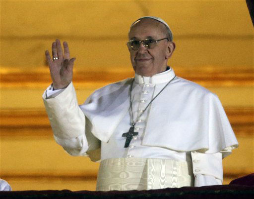 Pope Francis waves to the crowd from the central balcony of St. Peter&#39;s Basilica at the Vatican, Wednesday, March 13, 2013. Cardinal Jorge Bergoglio who chose the name of  Francis is the 266th pontiff of the Roman Catholic Church.   <span class=meta>(AP Photo&#47; Gregorio Borgia)</span>