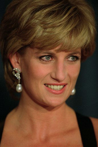 ** FILE ** In a file photo Princess Diana smiles at a charity dinner in New York on Dec. 11, 1995.  Publisher William Morrow has confirmed to The Associated Press that Paul Burrell&#39;s &#34;The Way We Were,&#34; the latest tell-all about Princess Diana goes on sale Sept. 12, 2006. Burrell, her former butler, also wrote the 2003 best-seller, &#34;A Royal Duty.&#34; &#40;AP Photo&#47; Mark Lennihan&#41; <span class=meta>(AP Photo&#47; MARK LENNIHAN)</span>
