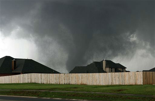 A tornado moves past homes in Moore, Okla. on Monday, May 20, 2013.   <span class=meta>(AP Photo&#47; Alonzo Adams)</span>