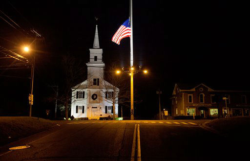 A U.S. flag flies at half-staff on Main Street in honor of the people killed when a gunman opened fire inside a Connecticut elementary school, Saturday, Dec. 15, 2012, in Newtown, Conn. <span class=meta>(AP Photo&#47; David Goldman)</span>