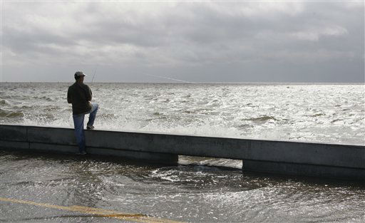 A fisherman takes advantage of the high tide and rising waves to try his hand at fishing from the seawall along Beach Boulevard in Waveland, Miss., as  Tropical Storm Isaac&#39;s winds begin to hit the Mississippi Gulf Coast, Tuesday, Aug. 28, 2012. Forecasters at the National Hurricane Center warned that Isaac, especially if it strikes at high tide, could cause storm surges of up to 12 feet &#40;3.6 meters&#41; along the coasts of southeast Louisiana and Mississippi and up to 6 feet &#40;1.8 meters&#41; as far away as the Florida Panhandle.   <span class=meta>(AP Photo&#47; Rogelio V. Solis)</span>