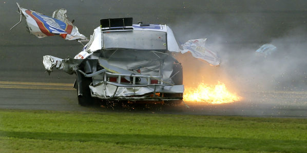Pieces of Kyle Larson&#39;s car fly through the air as he slides down the front stretch after he was involved in a multi-car crash on the final lap of the NASCAR Nationwide Series auto race at Daytona International Speedway, Saturday, Feb. 23, 2013, in Daytona Beach, Fla. &#40;AP Photo&#47;John Raoux&#41; <span class=meta>(AP Photo&#47; John Raoux)</span>