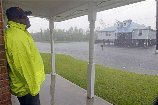 "<div class=""meta image-caption""><div class=""origin-logo origin-image ""><span></span></div><span class=""caption-text"">Waveland public works employee Darryl Antoine looks over his cousin's house near the beach in Waveland, Miss., as Isaac's rain and winds flood the street Wednesday, Aug. 29, 2012, the seventh  anniversary of Hurricane Katrina hitting the Gulf Coast. Antoine had been making his rounds of checking the city's water wells when he made a quick stop to make sure the house was secure.   (AP Photo/ Rogelio V. Solis)</span></div>"