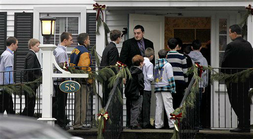 Mourners arrive for the funeral service of Sandy Hook Elementary School shooting victim, 6-year-old Jack Pinto, Monday, Dec. 17, 2012, in Newtown, Conn. Pinto was killed when a gunman walked into Sandy Hook Elementary School in Newtown Friday and opened fire, killing 26 people, including 20 children.&#40;AP Photo&#47;David Goldman&#41; <span class=meta>(AP Photo&#47; David Goldman)</span>