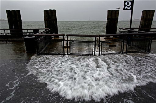 Waves wash over the sea wall near high tide at Battery Park in New York, Monday, Oct. 29, 2012 as Hurricane Sandy approaches the East Coast. Hurricane Sandy continued on its path Monday, forcing the shutdown of mass transit, schools and financial markets, sending coastal residents fleeing, and threatening a dangerous mix of high winds and soaking rain.?&#40;AP Photo&#47;Craig Ruttle&#41; <span class=meta>(AP Photo&#47; Craig Ruttle)</span>