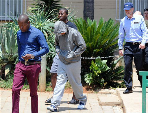 "<div class=""meta ""><span class=""caption-text "">Olympic athlete Oscar Pistorius leaves the Boschkop police station, east of Pretoria, South Africa, Thursday, Feb. 14, 2013 en route to appear in court charged with murder.  Olympic athlete Oscar Pistorius was taken into custody and was expected to appear in court Thursday after a 30-year-old woman who was believed to be his girlfriend was shot dead at his home in South Africa's capital, Pretoria.   (AP Photo/ Chris Collingridge)</span></div>"