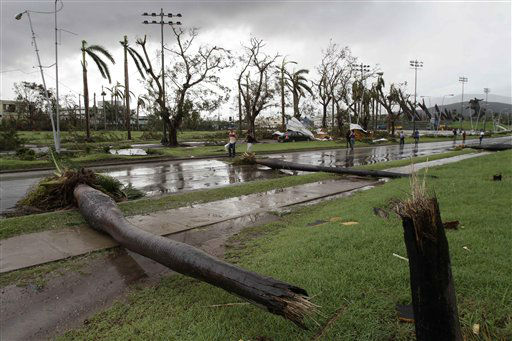 "<div class=""meta ""><span class=""caption-text "">Fallen palm trees lie on a road after the hurricane Sandy in Santiago de Cuba, Cuba, Thursday Oct. 25, 2012. Hurricane Sandy blasted across eastern Cuba on Thursday as a potent Category 2 storm and headed for the Bahamas after causing at least two deaths in the Caribbean.  (AP Photo/ Franklin Reyes)</span></div>"
