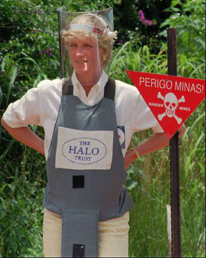 Diana, Princess of Wales, wearing protective gear, Wednesday Jan. 15, 1997, during a briefing by the British land-mine sweeping organisation Halo Trust in Huambo, central Angola, one of the most densely mined areas in the country. The sign reads &#34;Danger-Mines&#34;. Diana is visiting Angola in an effort to raise awareness on the problems of landmines. &#40;AP Photo&#47;Giovanni Diffidenti&#41; <span class=meta>(AP Photo&#47; GIOVANNI DIFFIDENTI)</span>