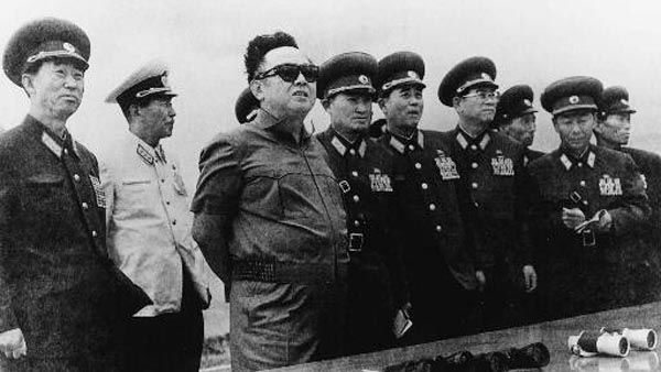 Kim Jong Il, third from left, supreme commander of the North Korean military, inspects a front line observation post of the North Korean Peoples&#39; Army 287 Unit in an undisclosed point in North Korea Sept. 15, 1997.   Kim, 55, was formally named head of the ruling party Wednesday, Oct. 8, 1997, taking one of the formal titles left vacant when his father died in 1994. &#40;AP Photo&#47;Korea News Service&#41; <span class=meta>(AP Photo&#47; XCJ OTA)</span>