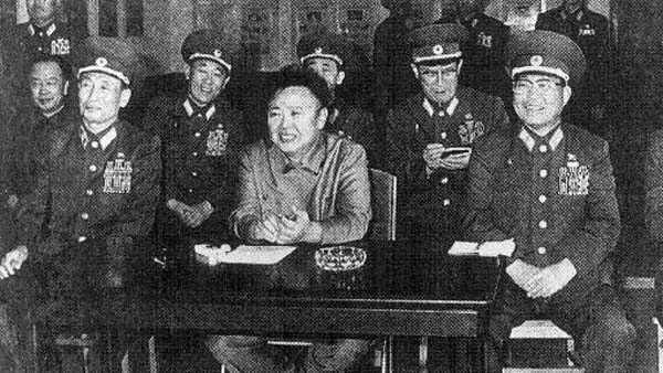FILE--North Korean de facto leader Kim Jong Il, center, smiles with military commanders as they view art performances of the 576th unit of the North Korean military, in this Sept. 28, 1997 file photo, distributed by Korean News Service Wednesday, Oct. 8, 1997. Kim Jong Il, North Korea&#39;s undisputed leader for the last three years, was formally named head of the ruling party Wednesday, taking on one of the titles left vacant when his father died in 1994.  &#40;AP Photo&#47;Korea News Service&#41; <span class=meta>(AP Photo&#47; OGU TN)</span>